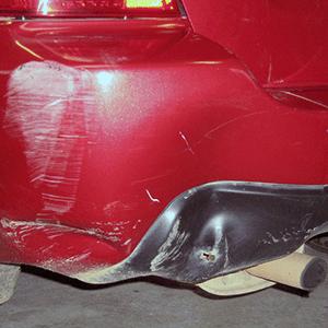Before car dent repair of rear corner bumper