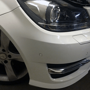 White Car Bumper With Scuff After Treatment