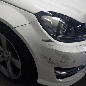 White Car Bumper With Scuff Before Treatment