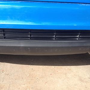 After paintless dent repair of rear bumper